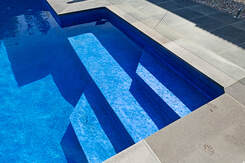 fresh polished concrete around modern swimming pool